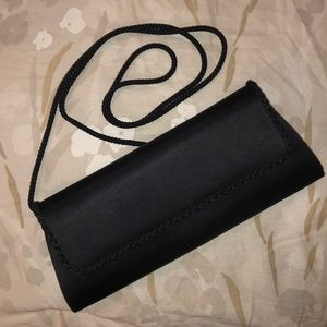 Small evening black clutch with strap.